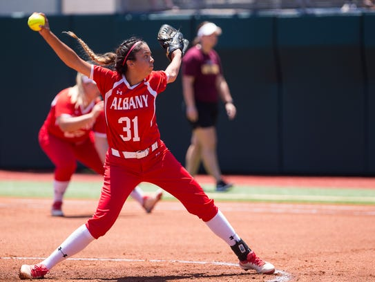 Albany's Reyna Garcia throws a pitch during the first inning of the 2A state semifinal game against Bells High School. Garcia gave up three runs and the Lady Lions played from behind in a 13-0 loss.