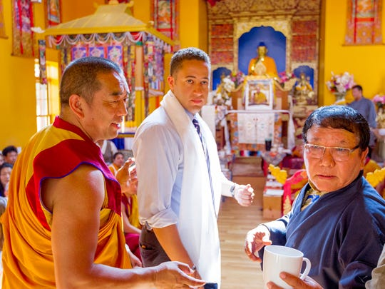The Namgyal Monastery announced Wednesday that Ithaca has been selected to host an educational institution to hold materials from 14 Dalai Lamas. From left, Ven. Tenzin Choesang, Ithaca Mayor Svante Myrick, and Ngawang Dhondup, the administrator of the Namgyal Monastery talk Wednesday morning at the celebration of the current Dalai Lama's 81st birthday.