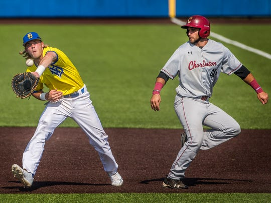 Delaware's Nick Patten catches a soft pop-up for an out after he was interfered with on the play by Charleston's Joey Mundy (right) in the University of Delaware's 17-4 win over College of Charleston at Bob Hannah Stadium in Newark on Thursday afternoon. Mundy was called out in the play as well.