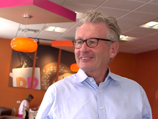 Nigel Travis CEO and chairman of Dunkin'' Brands visits the Farmington store at 20788 Farmington Road while he was in Detroit in March. The company is looking to add 20 plus stores in the next five years in metro Detroit.