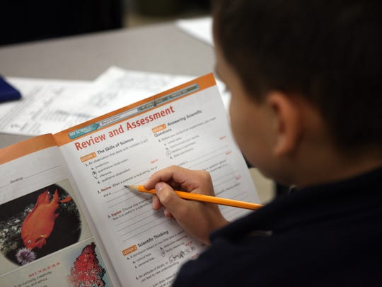 A student works in a workbook during a science class at Cope Middle School in Bossier City on Wednesday, Oct. 5, 2011. Greg Pearson/The Times