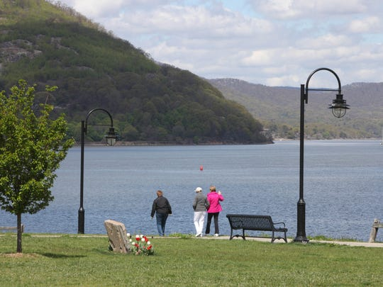 Walkers enjoy the Peekskill Southern Waterfront Park and Trailway along the Hudson River in Peekskill.