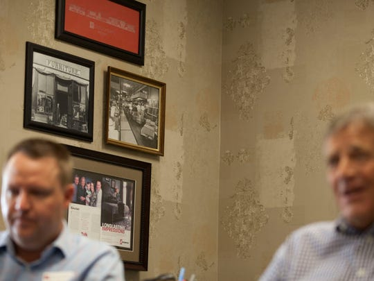 Montgomery's President Eric Sinclair (left) and CEO Clark Sinclair sit in front of photos in the office of Montgomery's, Aug. 3, 2018 in Sioux Falls, SD.