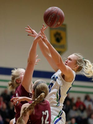 Green Bay Notre Dame's Lizzie Opichka fights for a rebound against De Pere on Friday at Notre Dame Academy in Green Bay. De Pere ended the Tritons' 10-game win streak.
