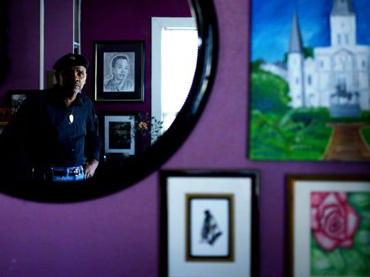 Jerry Davenport stands next to his art work.