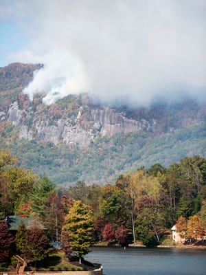Smoke from the Party Rock fire near Lake Lure spreads as emergency services and the N.C. Forest Service work to contain the blaze Wednesday.