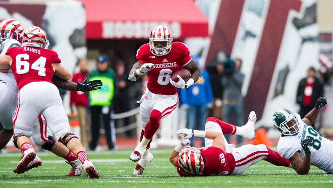 Indiana University junior Tevin Coleman (6) rushes the ball into the Michigan State secondary during the first half of action. Indiana University hosted Michigan State University in Big Ten football action, Saturday, October 18, 2014, in Bloomington, Ind.