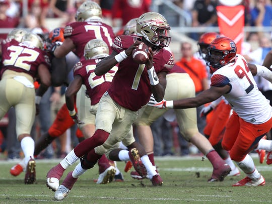 FSU's James Blackman scrambles out of the pocket against