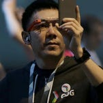 A man wearing Google Glass waits for the Google I/O 2015 keynote presentation in San Francisco, Thursday, May 28, 2015.