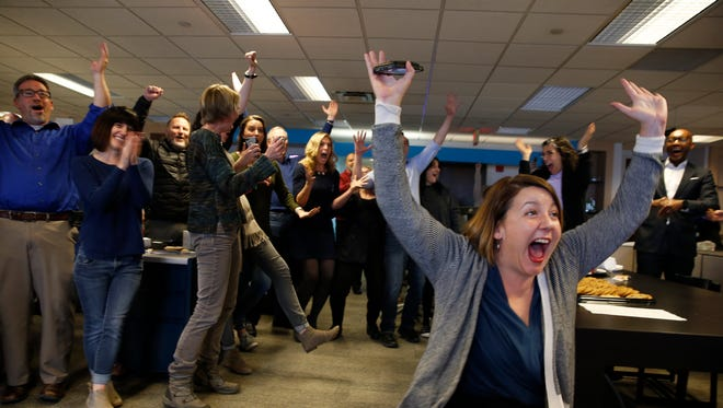 Staff members of the Cincinnati Enquirer celebrate winning the Pulitzer Prize for Seven Days of Heroin coverage. Photo shot Monday April 16, 2018