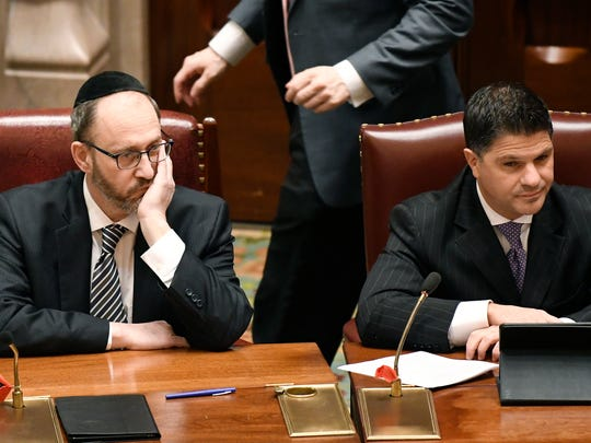 Sen. Simcha Felder, D-Brooklyn, left, and Sen. George Amedore Jr., R-Rotterdam listen as members debate bills in the Senate Chamber at the state Capitol Friday, March 30, 2018, in Albany, N.Y.