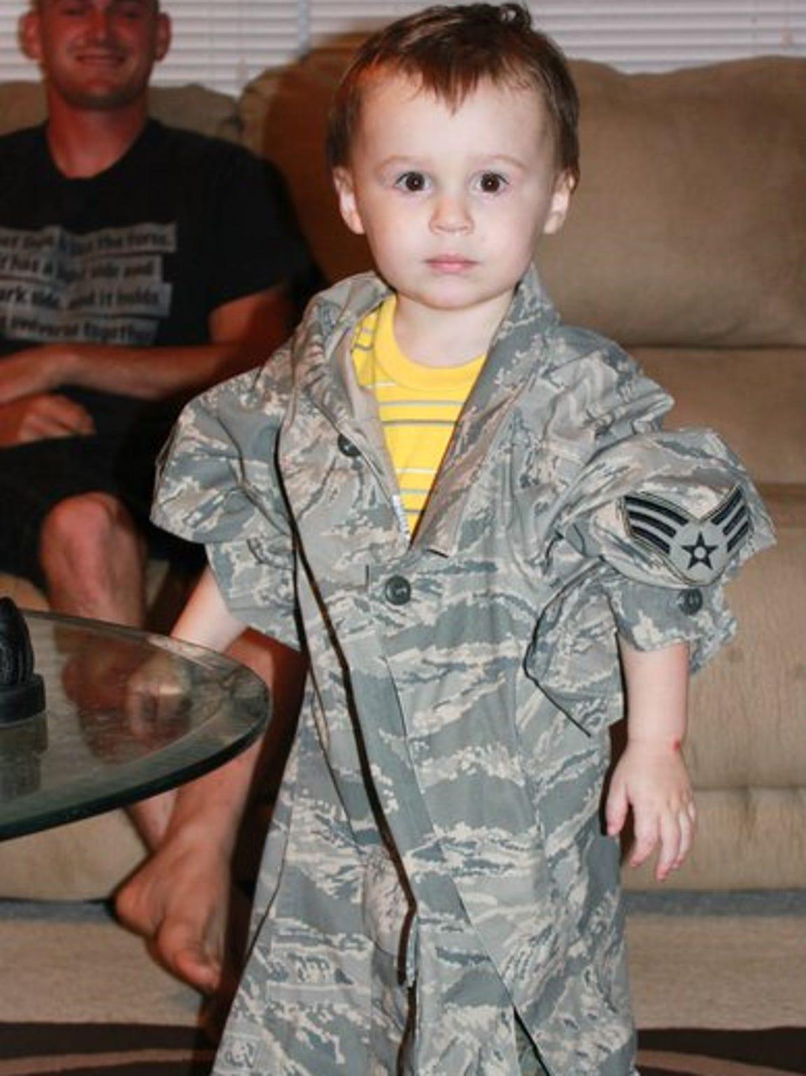 Jayden models his father's Air Force uniform.