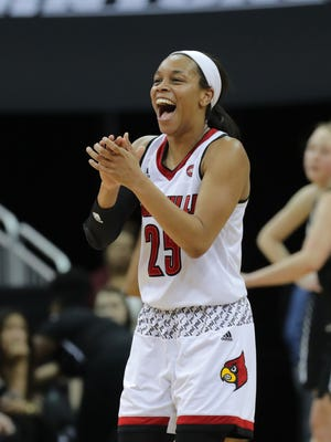 Louisville's Asia Durr celebrates after getting fouled while knocking down a three.