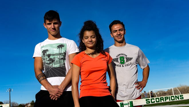 From left, Axel Fowler, Kiara Quezada and Vincent Gomez poses for a portrait on Wednesday at Hutchison Stadium in Farmington.
