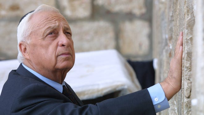 Ariel Sharon places his hand on the Western Wall, Judaism's holiest site, in the Old City of Jerusalem on Feb. 7, 2001.