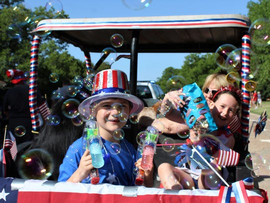 Carson Turner, 6, fires away with his bubble gun at the Hillcrest neighborhood parade.