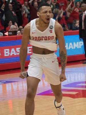 Aiken grad Carlik Jones (1) celebrates after sinking a 3-pointer to win the Big South Conference championship for Radford against Liberty, Sunday, March 4, 2018, in Radford Va.