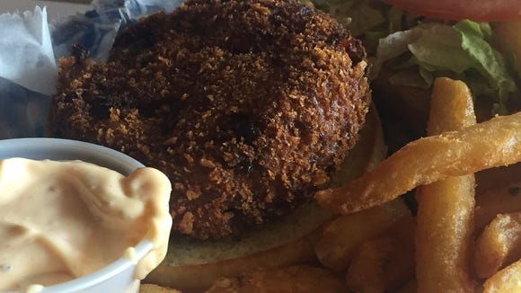 The crab cake sandwich at Old Fish House Bar and Grill in Grant features a crisp, flavorful cake full of sweet crab meat.
