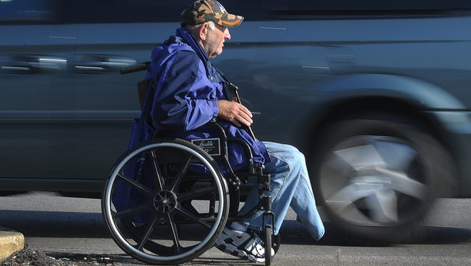Two heart attacks and losing his left foot to diabetes have left Ken Perdue, 67, Indianapolis, sitting next to traffic lanes at an Eastside shopping center asking for money to make ends meet.