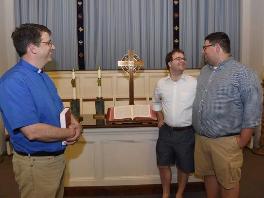 Rev. Mark Mast, left, stands with Kyle Pogemiller,