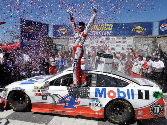 Kevin Harvick celebrates after winning the Monster