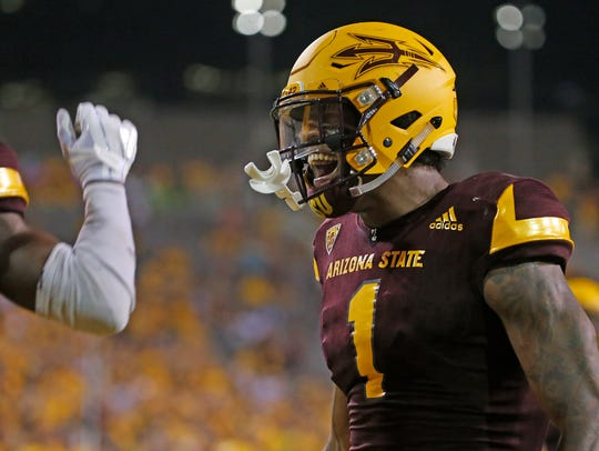 ASU's N'Keal Harry (1) celebrates with John Humphrey