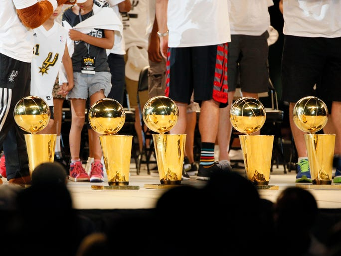 The Spurs displayed the franchise's five championship trophies during a celebration through San Antonio to commemorate the latest title, won earlier this week over the Miami Heat.