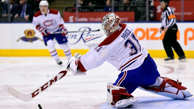 Montreal Canadiens goalie Carey Price stick-handles the puck away from the net during the second period against the Toronto Maple Leafs in Toronto on Saturday.