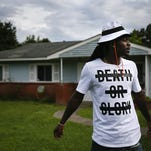 """Cincinnati Bengals fourth-year cornerback Dre Kirkpatrick, 25, stands in front of his childhood home as he describes growing up in the troubled Oakleigh Estates neighborhood of Gadsden, Ala., on Friday, June 12, 2015. Kirkpatrick pointed to numerous homes on the street, citing, """"That was a drug house, that was a drug house, that was a drug house."""" Kirkpatrick recalled pick-up games of basketball in a neighbor's yard that eventually stopped after a drive-by shooting that injured three of the people playing."""
