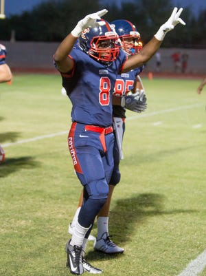 Centennial junior Carl Barrs celebrates after a play in the first quarter against the Chandler Wolves, Friday, Aug. 29, 2014, in Peoria, Ariz.