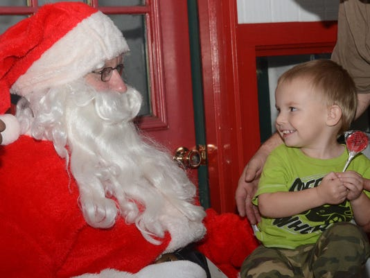 ANI Holiday Magic Quentin Rush, 2, grins while meeting Santa Claus at Holiday Magic held Thursday, Dec. 4, 2014 in downtown Alexandria.-Melinda Martinez/mmartinez@thetowntalk.com, The Town Talk, Gannett