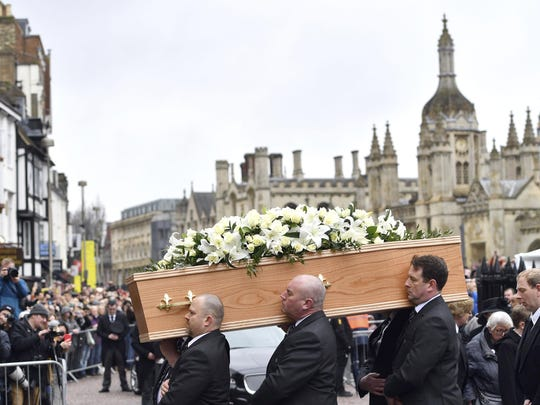 The coffin of Professor Stephen Hawking arrives at University Church of St Mary the Great as mourners gather to pay their respects, in Cambridge, England, Saturday March 31, 2018.