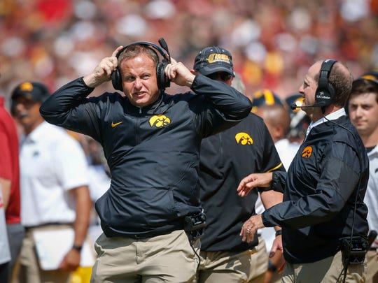 Iowa linebackers coach Seth Wallace reacts after an