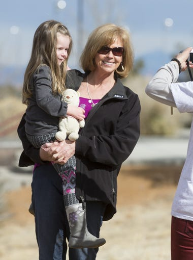 Marsha Mueller poses with her granddaughter, Lexi, 4, during a playground groundbreaking at Pioneer Park in Prescott honoring her daughter, American hostage Kayla Mueller. Kayla, aid worker, was confirmed dead almost on year ago.