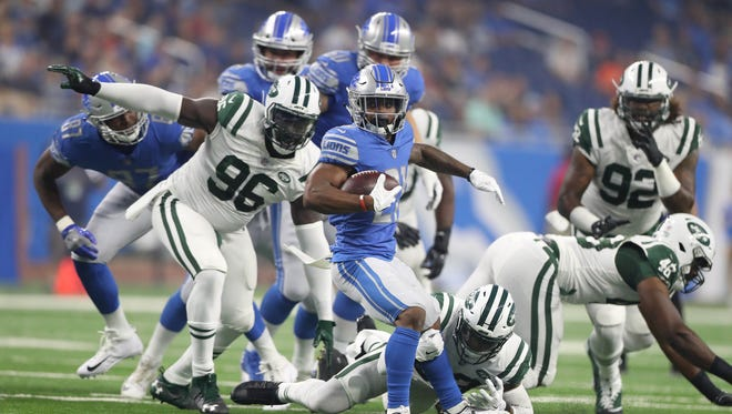 Ameer Abdullah runs against the Jets during first-quarter action Saturday, Aug. 19, 2017 at Ford Field in Detroit.