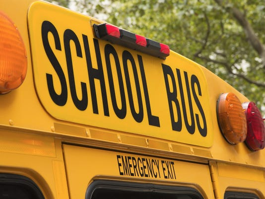 Back of school bus with a sign