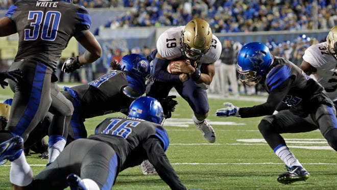Mark Humphrey / APNavy quarterback Keenan Reynolds is stopped at the 2 by Memphis defenders in the first half of Saturday's game at the Liberty Bowl. Navy quarterback Keenan Reynolds (19) is stopped at the two-yard line by Memphis defenders Shareef White (30),  Wynton McManis (16) and defensive back DaShaughn Terry, right, in the first half of an NCAA college football game Saturday, Nov. 7, 2015, in Memphis, Tenn. (AP Photo/Mark Humphrey)