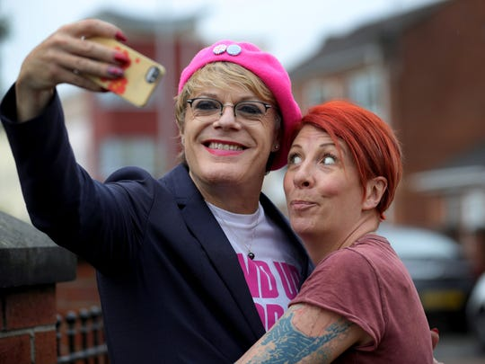 Hulme resident Rachel Morris, right, has a selfie with comedian and actor Eddie Izzard as he campaigns for Labour In on June 10, 2016, in Manchester, England. Izzard joined Labour activists to campaign on the streets of Hulme, Manchester, to canvass for votes for UK citizens to stay in the European Union.
