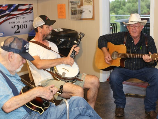 Bert Hudson, Randy Blackwood and Pete Shains strum and sing together in a weekly jam session Thursday, Aug. 17, at the VFW on South Browning Street.
