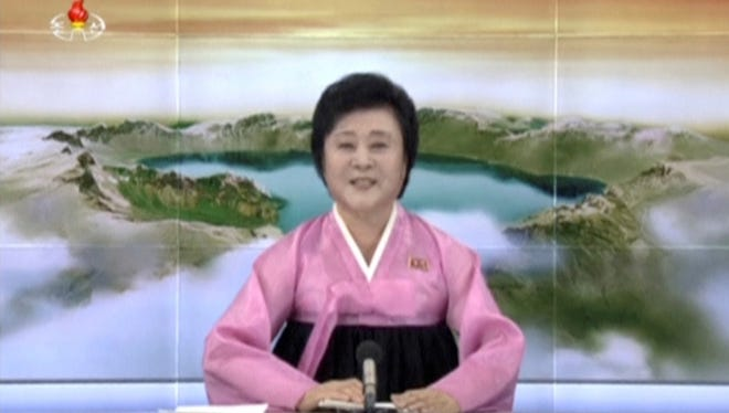 "Ri Chun Hee, the ""Pink Lady,"" makes an important announcement on North Korean television."