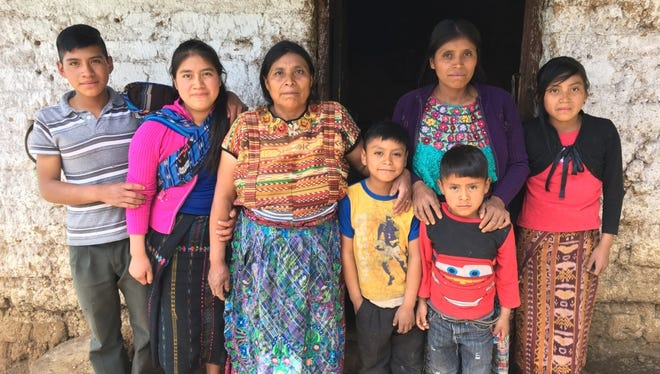 Elvira Mauricia Diaz with her family, including Oscar, 6, and Brian, 8, who live in a mountainous village town near Comitancillo, Guatemala. The children's health has suffered as extreme weather swings have cut into the family's ability to grow enough food.