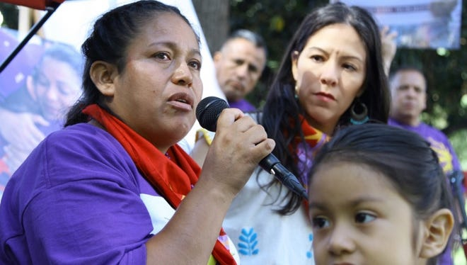 Janitor Georgina Hernández and her daughter at a hunger strike outside the State Capitol in Sacramento, Calif.