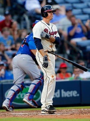 Atlanta Braves' Kelly Johnson (24) throws his bat after striking out to end the sixth inning of a baseball game against the Chicago Cubs on Sunday in Atlanta. Chicago won 4-1.