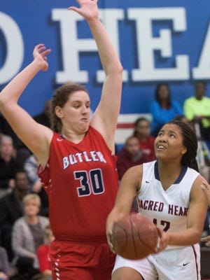 Sacred Heart guard Erin Toller looks to drive as she is defended by Butler center Molly Lockhart. 08 February 2017