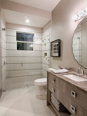 This bathroom in Divco's Baywood model in Pine Ridge features several elements of Universal Design. Shown here is a roll-in shower.