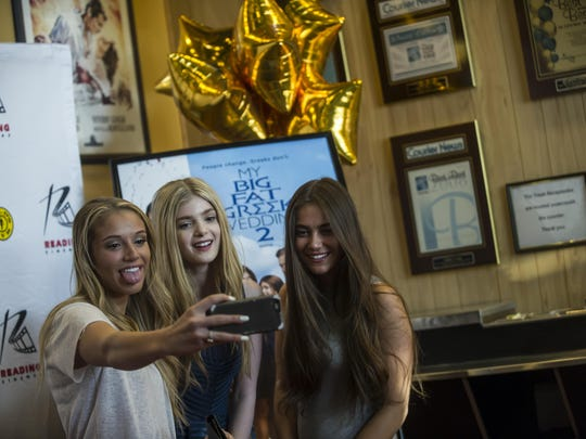 "Elena Kampouris, center, a Bridgewater-raised actress who stars in ""My Big, Fat Greek Wedding 2,"" poses for a selfie with Summer, left, and Savanna Zampetti, of Green Brook, at the Reading Cinemas in Manville on March 25, 2016."