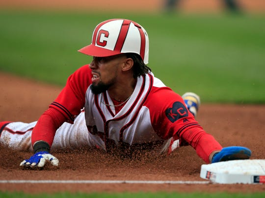 Kansas City Royals' Billy Hamilton slides into third base during the fourth inning of a baseball game against the Minnesota Twins at Kauffman Stadium in Kansas City, Mo., Sunday, June 23, 2019. Hamilton was safe with a stolen base. (AP Photo/Orlin Wagner)