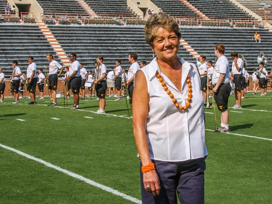 Judy Dooley stands during a UT Pride of the Southland Band pre-game rehearsal. She is retiring after working as assistant to the band directors for more than 20 years.