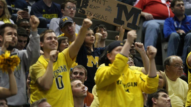 Michigan fans cheer against Wofford on March 20, 2014, in Milwaukee Wis.