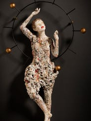 """Celestial Movement"" ceramic sculpture by Kirsten Stingle"